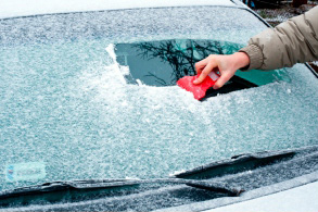 scraping off ice of windshield