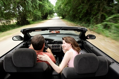 Couple driving in a convertible